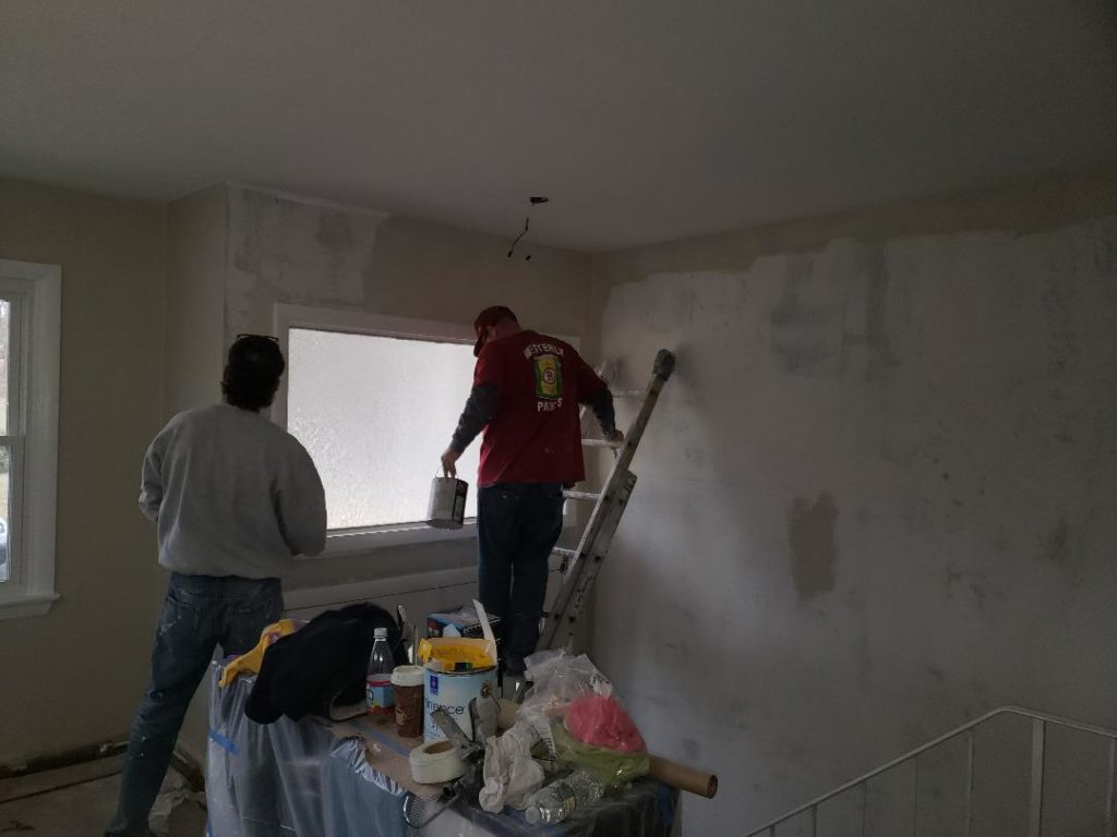 skiming wall then sanding, getting ready to prime